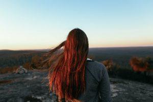 Red hair women look landscape