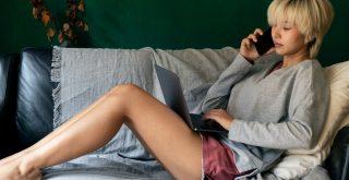 Woman sit on a sofa